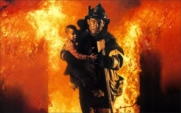 "Ron Howard's ""Backdraft"" is a movie half in love with fire, a film like ""Fahrenheit 451"" that finds something seductive in tendrils of smoke and boiling cauldrons of flame. Never before in the movies have I seen fire portrayed by such convincing, encompassing special effects. Unfortunately, they are at the service of an unworthy plot."