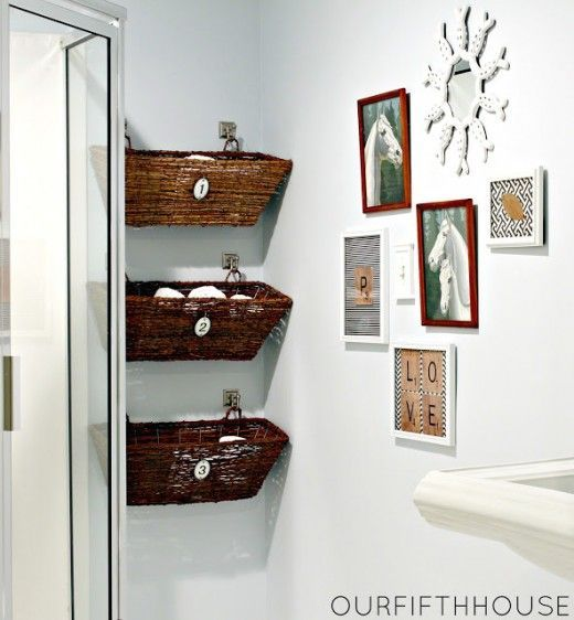 So many storage ideas for small spaces in the bathroom. Love the baskets on wall hooks