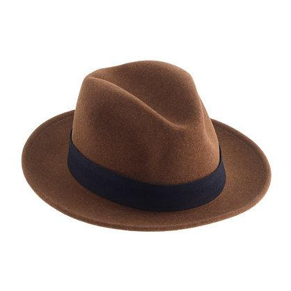 "This Brooklyn-based company, run by two brothers, is known for its timeless classics and workwear-inspired goods—including this handsome fedora. It's made right here in the USA with all the details you'd expect in a traditional fedora, including a snap brim and an indigo-dyed twill band. It's also stain- and water-repellent, which comes in handy for those ""Singin' in the Rain"" impressions that come out of nowhere. And, last but not least, it can only be found here at J.Crew. ..."