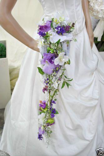 Brautstrauss-extravagant-handgefertigt-hochwertigen-Seidenorchideen-lila-Muff