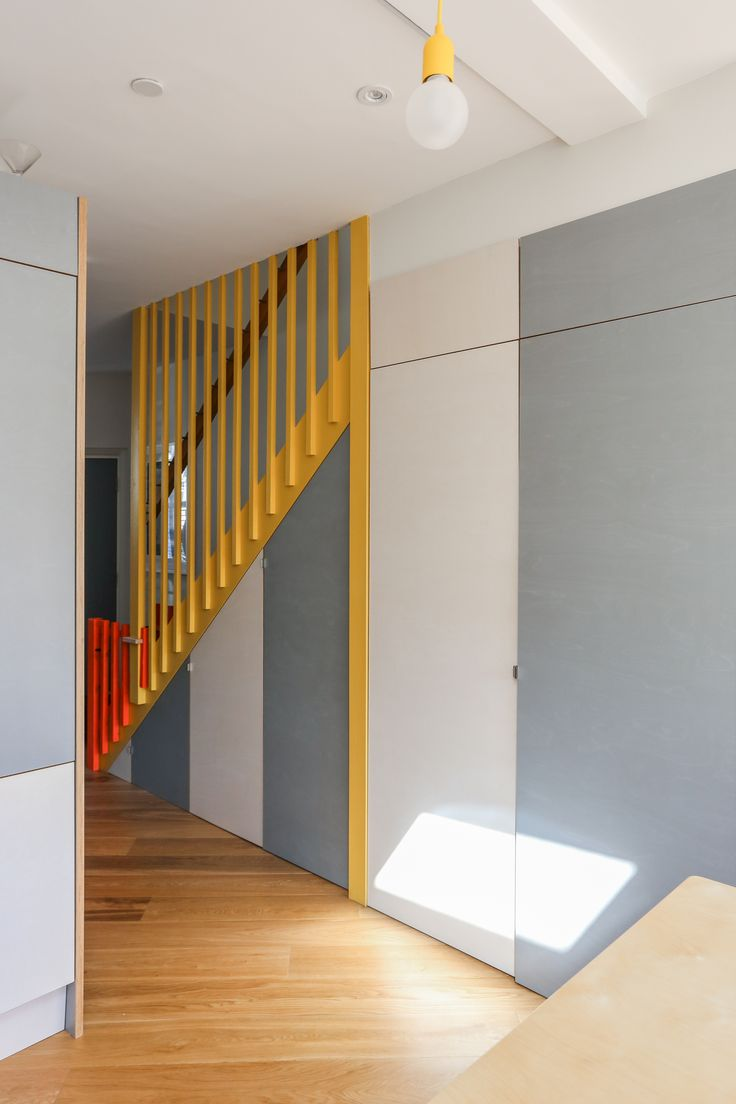 colourful bannister, angles, chevron, grey and white storage, stripes, yellow bannister, yellow and red, ply, yellow ceiling rose