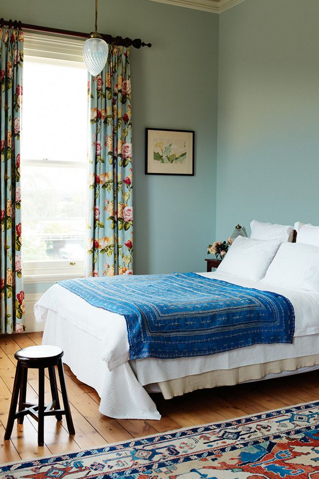 An electric blue bed cover adds a gorgeous pop of colour in this fresh looking country bedroom.