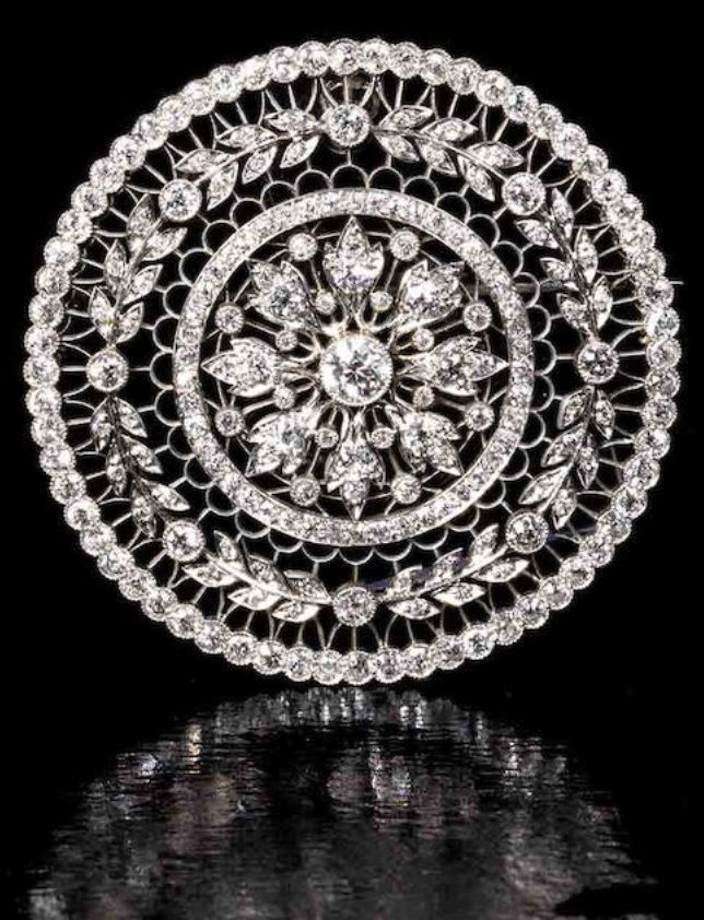 A Belle Époque diamond brooch, by T.B. Starr & Co, circa 1915. The circular…
