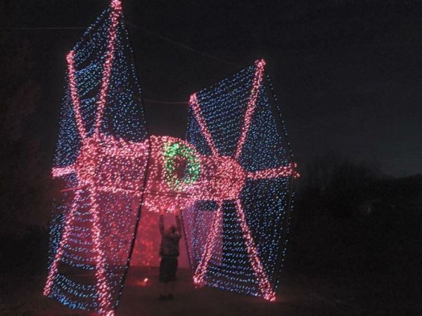 Tie-fighter-christmas-lights. It's a Star Wars Christmas Holiday lights special. Man Builds Tie-Fighter out of Christmas Lights in his Front Yard