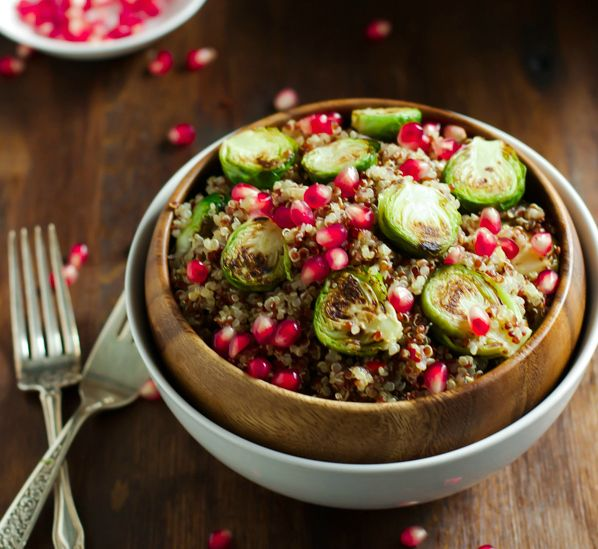 Roasted Brussels Sprouts Quinoa Salad - Primavera.      1 cup quinoa     2 cups water     1/2 teaspoon salt     2 cloves garlic, peeled     2 tablespoons extra virgin olive oil     1 tablespoon balsamic vinegar     2 cups brussels sprouts, cut in half     1/2 onion, diced     1/2 cup pomegranate seeds  For the Dressing:     3 tablespoons lemon juice     4 tablespoons extra virgin olive oil Kitchen