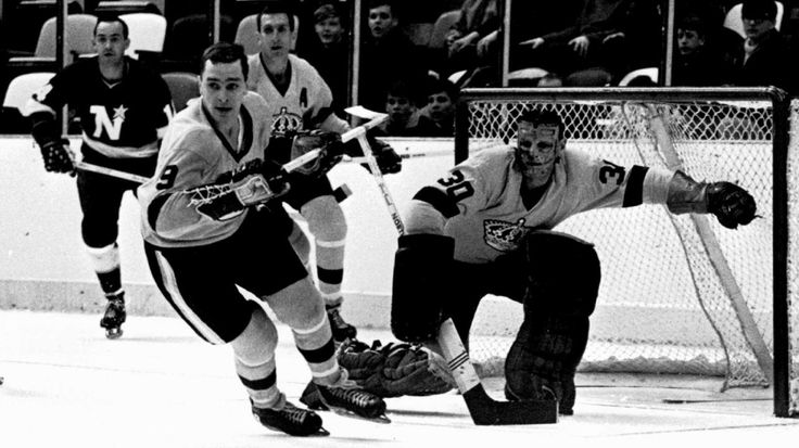INGLEWOOD, CA - 1967: Goalie Terry Sawchuk #30 of the Los Angeles Kings moves to make a save during an NHL game against the Minnesota North Stars circa 1967 at the Forum in Inglewood, California. (Photo by Bruce Bennett Studios/Getty Images)