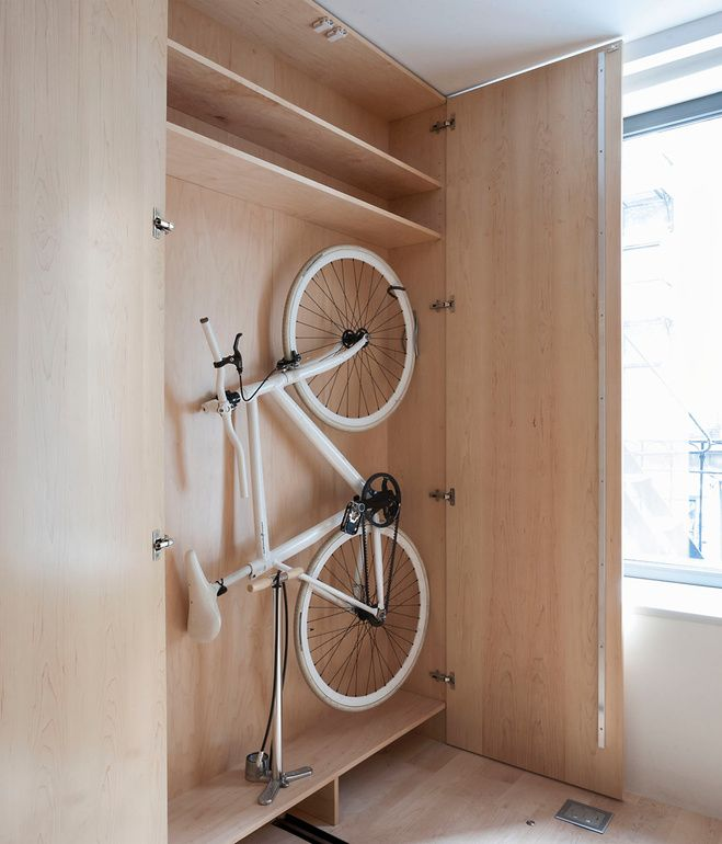 ThinBike, Hill Schindelhauer, features folding handlebars and pedals that allow it to easily fit snugly against a wall (or in this custom-sized cabinet).
