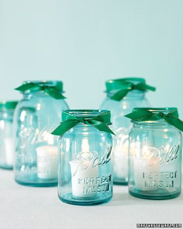 Vintage Mason jars hold votive candles