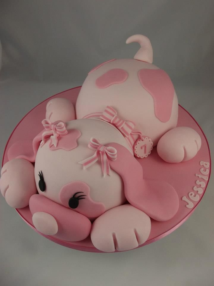 Pink puppy dog cake, I made this cake from Debbie Browns book. The dog in the book is blue but I was making this for a girl