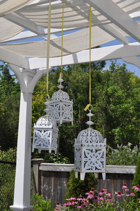 Pergola Shade Cover -DIY using home depot drop cloth sew into strips, add brass grommets.
