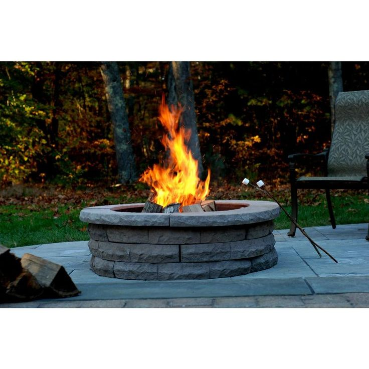 Best 25 fire pit ring ideas on pinterest fire ring for Fire pit on concrete slab