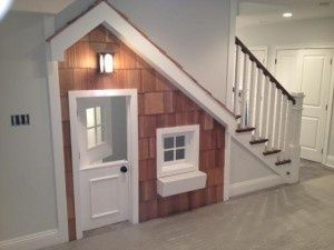 A play house built in under the stairwell in the basement