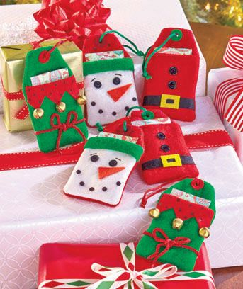 Set of 6 Felt Gift Card Holder Tags is a cute way to give someone a gift card or money. Fabric holders are shaped like gift tags with festive designs. Each is slightly stuffed and ready to hang on the tree or attach to a gift.