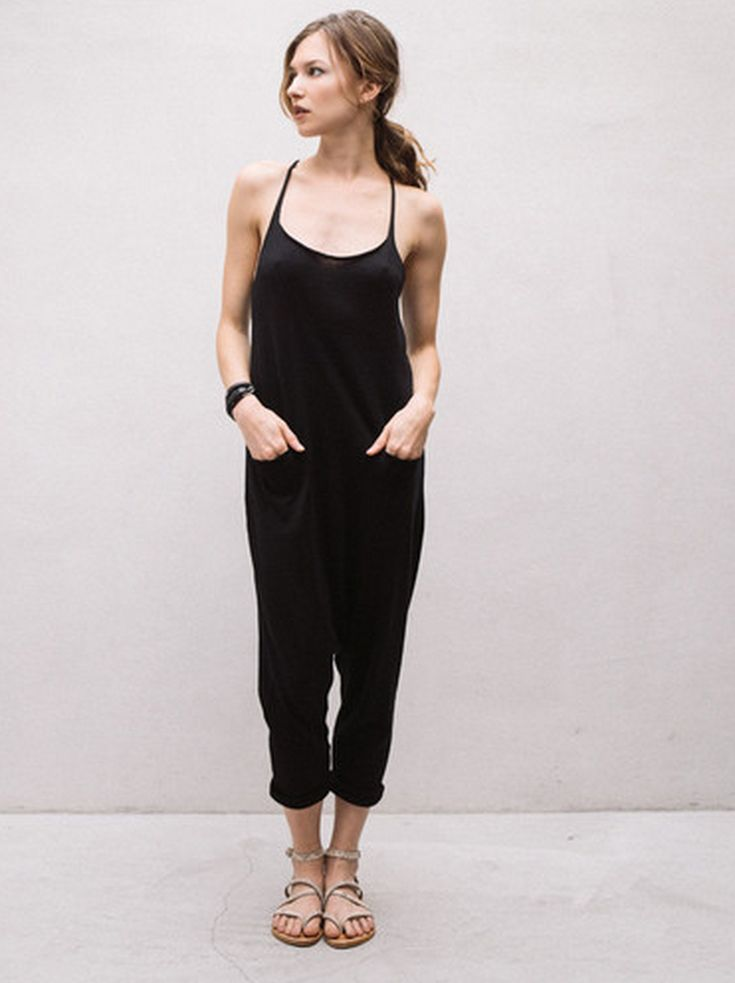 Use a black jumpsuit or maxi dress as a base then build your unique look with layers and printed accessories / the love assembly