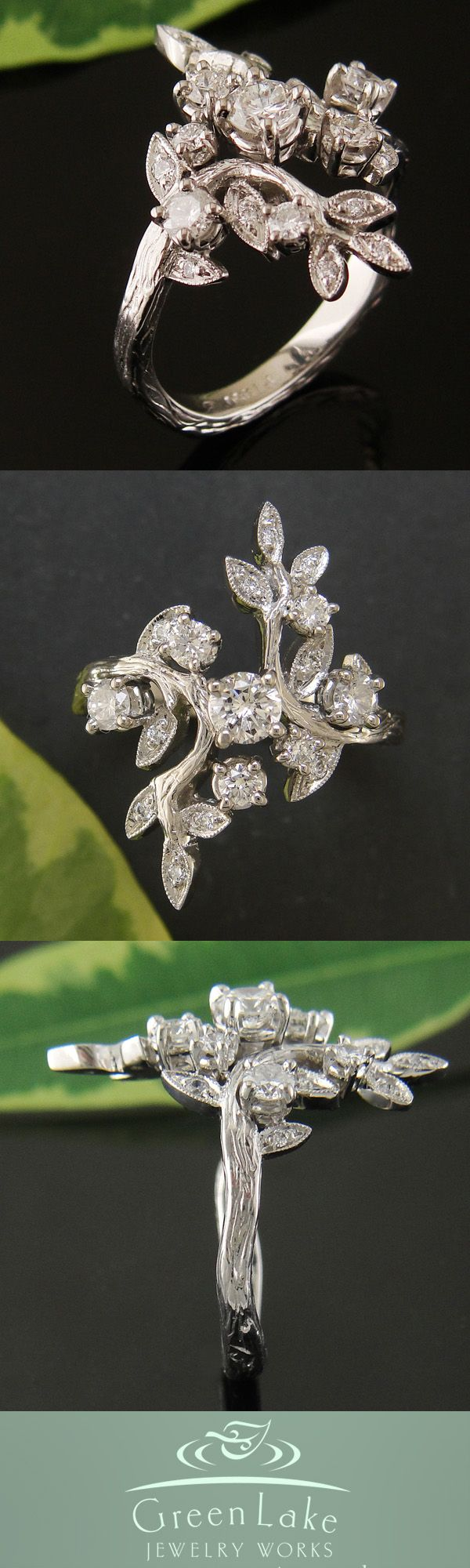 Custom platinum engagement ring, carved with two branches bearing little milgrained leaves set with diamonds