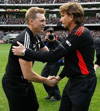 AFL 2012 Rd 05 - Collingwood v Essendon    Collingwood Coach Nathan Buckley (L) and Essendon Coach James Hird (R) shake hands before the AFL Round 05 ANZAC Day match between the Collingwood Magpies and the Essendon Bombers at the MCG, Melbourne. (Photo: Michael Willson/AFL Photos) AFL Media — at Melbourne Cricket Ground (MCG).