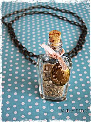 An empty nail polish bottle upcycled into a charm necklace      @amy szilagyi