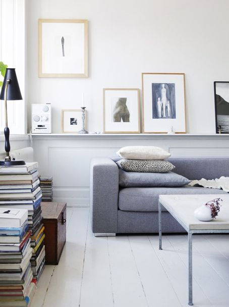 picture railing behind sofa