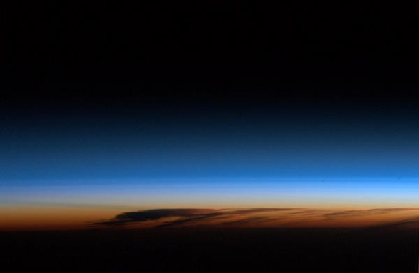 Our atmosphere has distinct layers; the troposphere and stratosphere are easily visible from orbit.