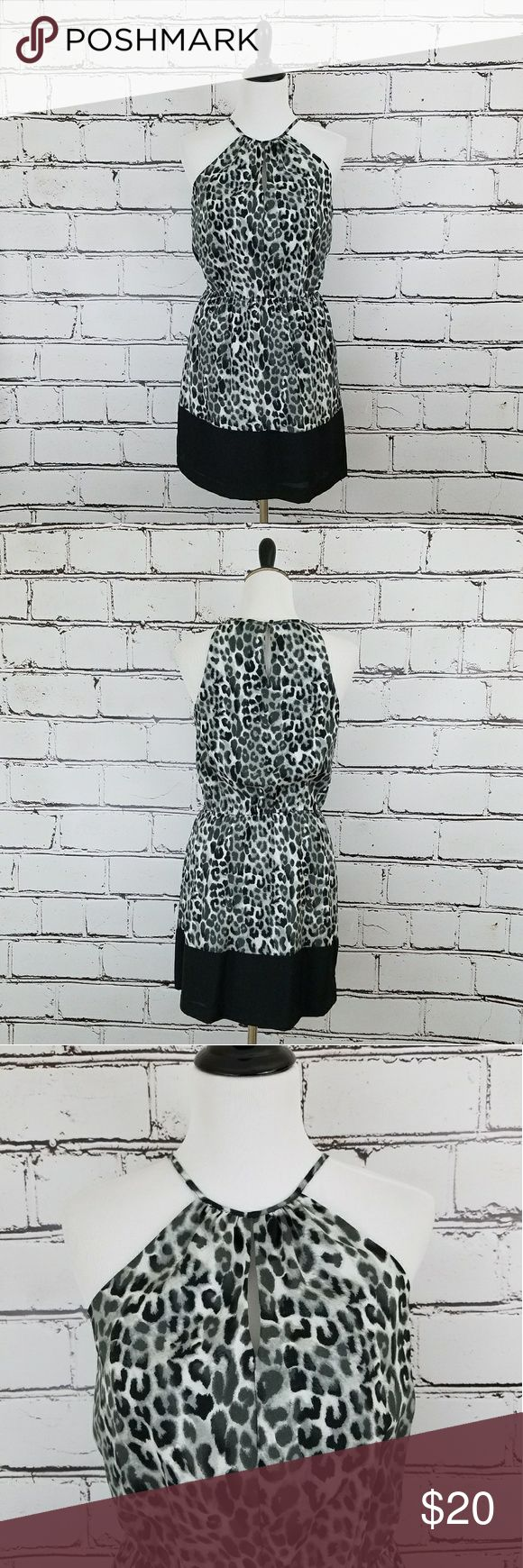Express Cheetah Print Dress! Black, white and gray colored cheetah print dress. Halter style neckline. Elastic waist. Length is about 36 inches and armpit to armpit is about 17 inches. Like new condition! Express Dresses