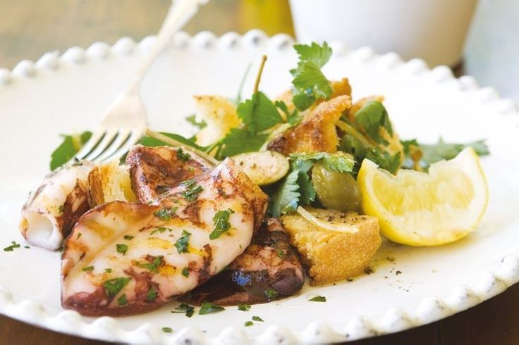 Grilled squid with parsley and caperberry salad