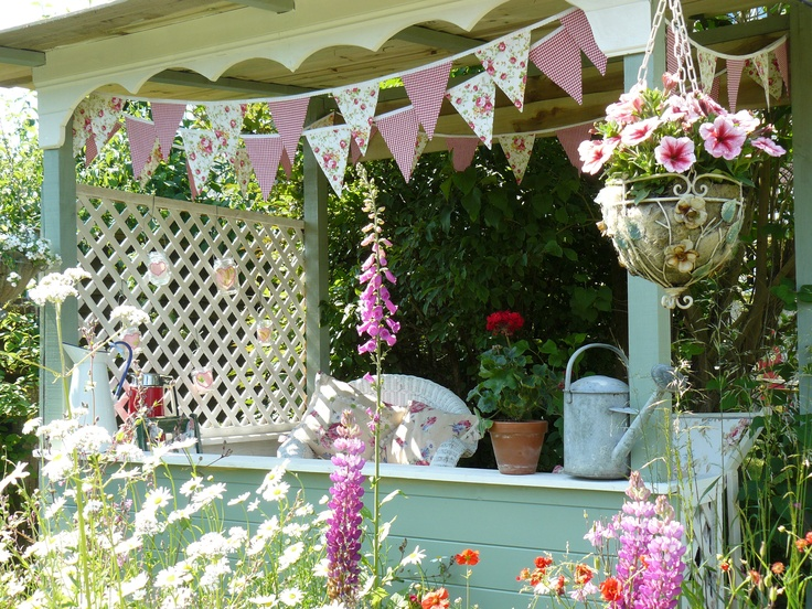 """Our little """"gazebo"""" that hubby built for Summer seating."""