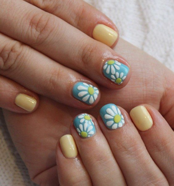 Camomile is a symbol of spring and summer, warmth, bright sun and blue sky. All of this is combined in one design for short nails. White camomile with bright yellow centre of a flower is made by acrylic modelling on a greenish-blue background. Pastel yellow is a basic color of a coat. Similar pedicure combined with open shoes will perfectly complement summer manicure.