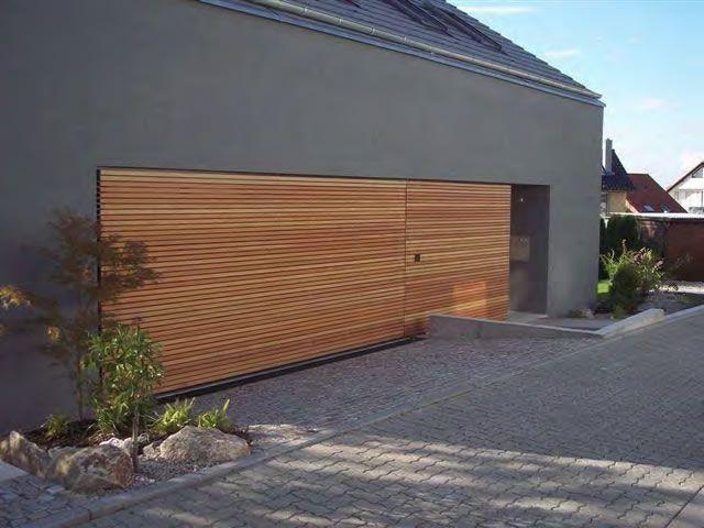 Modern garage door gallery doors pinterest modern for Cedar clad garage doors