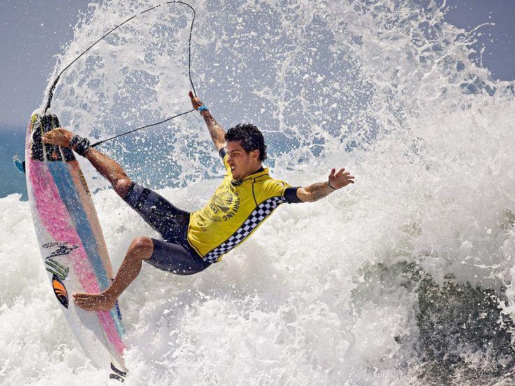 Winner of the men's U.S. Open surfing competition, Filipe Toledo of Brazil, shows balance in Huntington, Beach, California, USA. Photograph: Matt Masin/The Orange County Register/AP