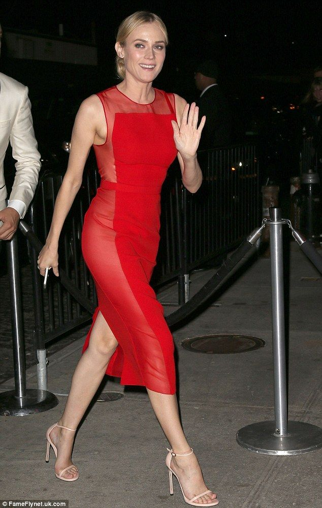 Red hot: The Helen of Troy star looked striking in her dress for the after party. The shee...