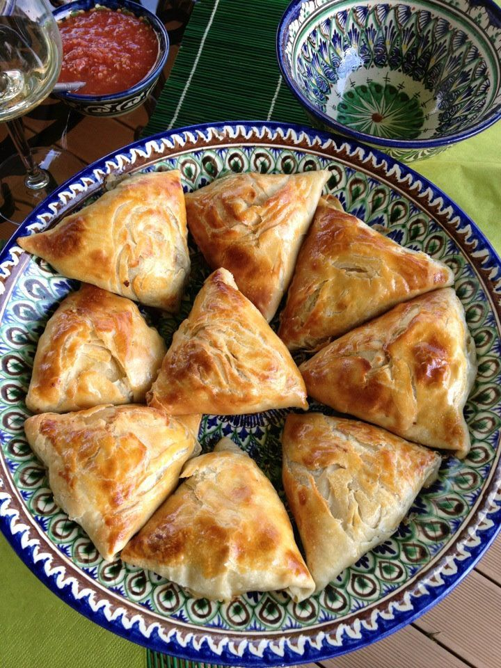 """Uzbek people (to be honest, Uzbek women) are the best makers of dough I have ever seen. In the Uzbek kitchen, a lot of dough-based recipes are available, deep-fried ones, steamed ones, and this recipe is prepared in the oven. These samsa's are stuffed lamb and minced onion but they are also available with pumpkin or meat.  Actually, samsa's are a national recipe in many countries, with slightly different ingredients, like Indian """"samosa's"""" or Lebanese """"sambosik""""."""