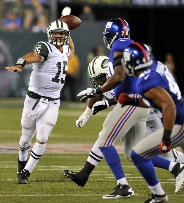 New York Jets quarterback Tim Tebow rushes against the New York Giants during the third quarter of their pre-season NFL football game in East Rutherford, New Jersey August 18, 2012. REUTERS/Adam Hunger