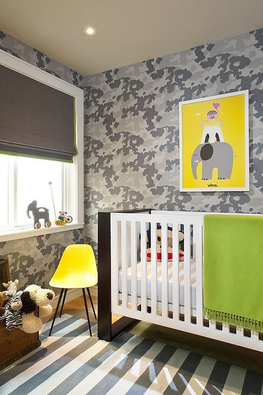 modern nursery with grays and yellow and splash of green. Is that camo wall paper?!