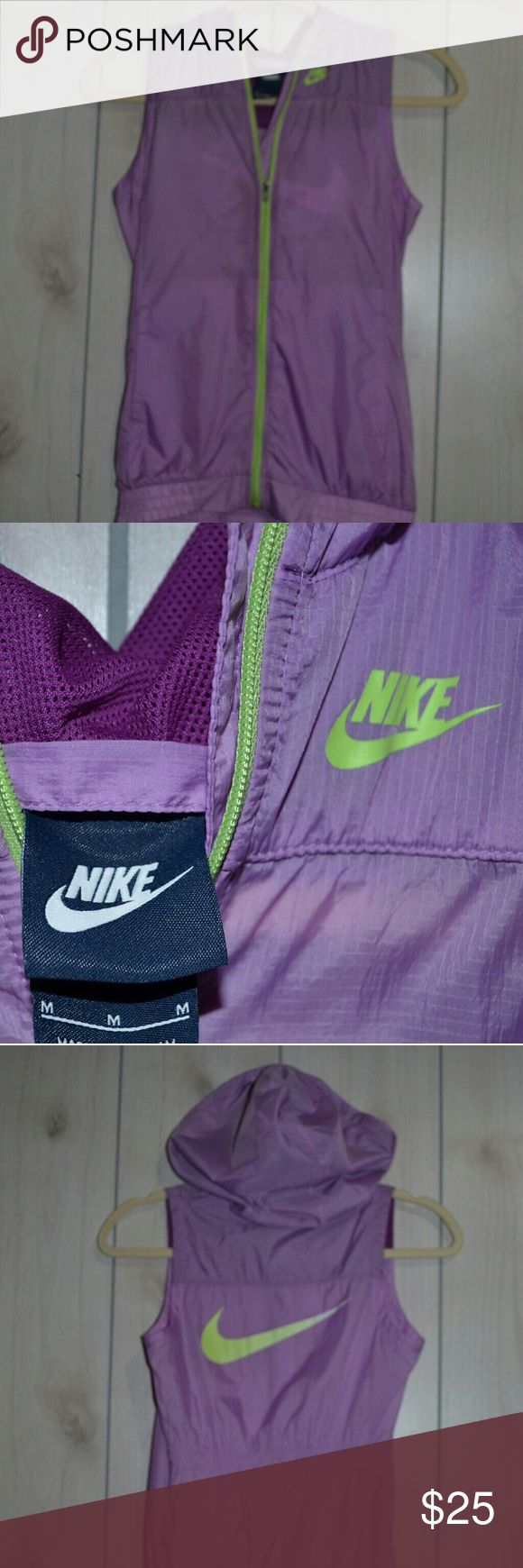 Nike Sporty Vest Purple and neon green nike vest. The tag says medium, but runs small. Fits more like a small or extra small. There in a hood, and also two pockets. Nike Jackets & Coats Vests