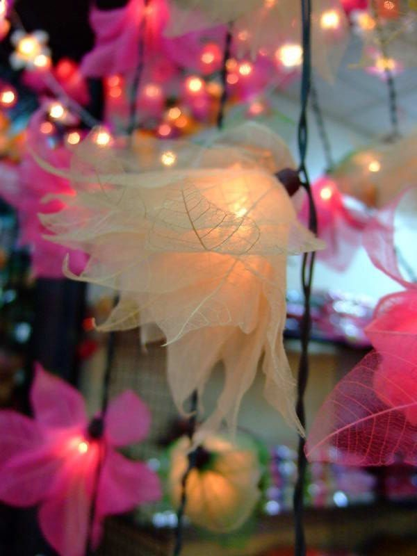 Ivory Skeleton leaves glued to a string of holiday lights - DIY project that looks like delicate flowers of light!