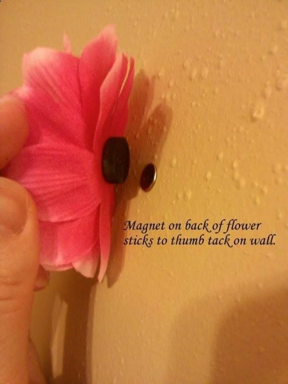 So cute for a little girls room! Magnet glued to a flower and attached to a thumb tack in the wall! Minimal holes to fill in later!