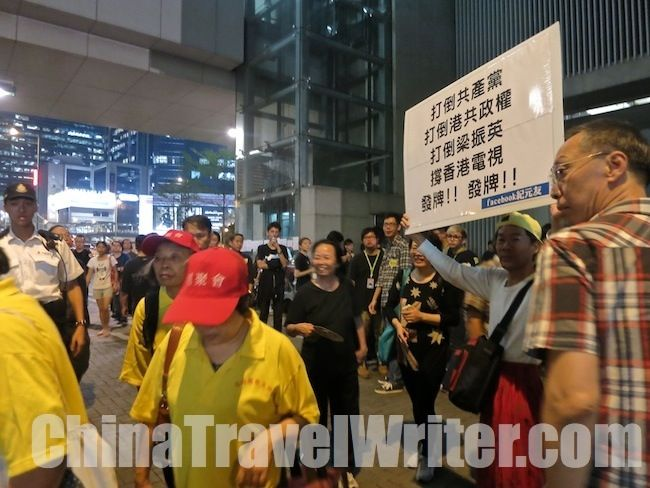 The pro-government activists get jeered by the huge crowd of pan-democrat (anti-government) activists.  Read the full story here: http://thechinachronicle.com/hong-kong-tv-vote-delayed-aggressive-protesters-surround-legislative-council/