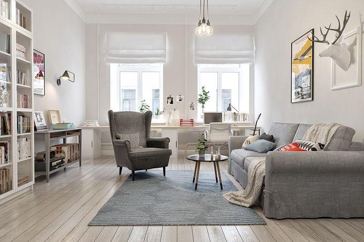 pavimento in parquet chiaro in un salotto con divani e poltrona grigi