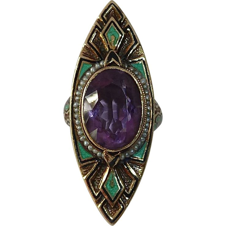 Art Deco gold ring c1920s.  Made in 14k yellow gold.A faceted amethyst is bezel set in the center, the bezel is framed with tiny seed pearls wired around the setting.
