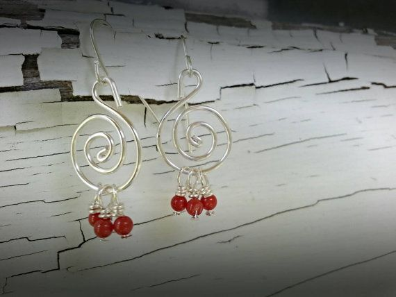 Check out this item in my Etsy shop https://www.etsy.com/listing/457574646/swirl-red-bead-earrings