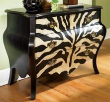 Add a bit of excitement with the enticing pattern and curves of this three Zebra drawer chest. The antique brass finish hardware is highly detailed and decorative. Curved sides, top, apron, and side rails make for a jazzy silhouette. Painted zebra animal print and black finish. Antique brass finish hardware. Three drawers.