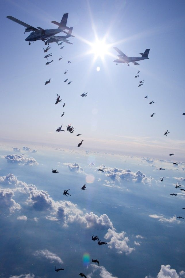 Let's all go down together: Amazing pictures as 108 skydivers set new world record for freefall formation   Mail Online