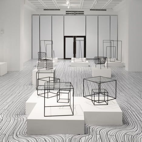 Japanese designers Nendo will draw black and white floorboards that appear to flow around plinths for their solo show at the National Taiwan Craft Research and Development Institute
