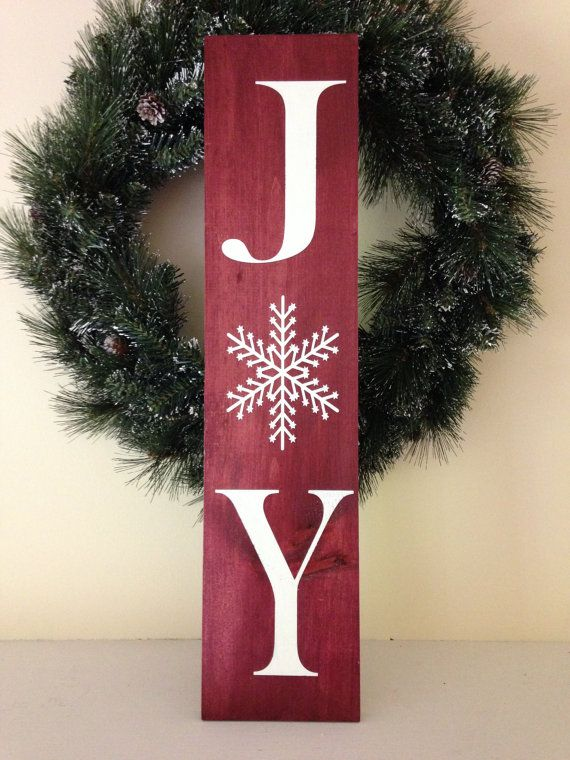 A simple way to make your home more festive for the holiday season. Also makes a great gift for friends, family and coworkers! Available in a medium cinnamon brown or in cheerful Christmas red.  Measures approximately 5.5 wide and 24 long. Protected with a clear topcoat finish. Can be hung on a single nail, or leaned against a wall. Hand-painted on solid wood.  Please specify background colour when ordering.