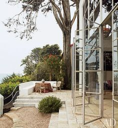 Steel windows fabricated by Pierre Quinton open to a view of the Pacific Ocean | archdigest.com