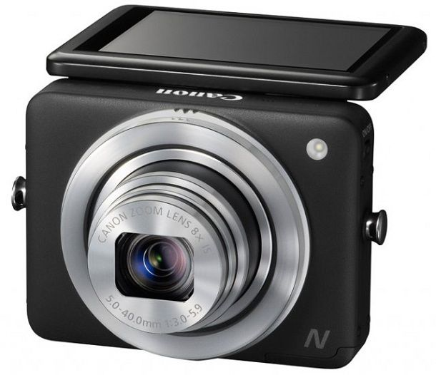 Canon PowerShot N    Japanese company Canon has brought to CES 2013 compact camera with an unusual design – PowerShot N. The camera is enclosed in a square enclosure has an 8x optical zoom lens (28-224 mm) and tilting touch screen (461,000 pixels), as well as Wi-Fi-module to communicate with smartphones and fill the footage in social networks and on YouTube.