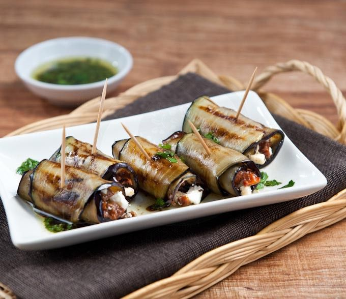 Grilled aubergine rolls stuffed with sun-dried tomatoes and manouri cheese