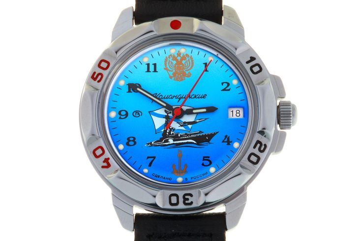 WATCH VOSTOK KOMANDIRSKIE 431139 RUSSIAN NAVY. At the top of the watch, at the twelve-hour point, there is a golden National Emblem of Russian Federation. In the central part there is a composition of a missile boat and a submarine skimming the waves, and a military aircraft flying under the waving of St. Andrew's flag of the Russian Navy. #russian #mechanical #military #watches #vostok #komandirskie #gifts #souvenirs #anchor #eagle #warship