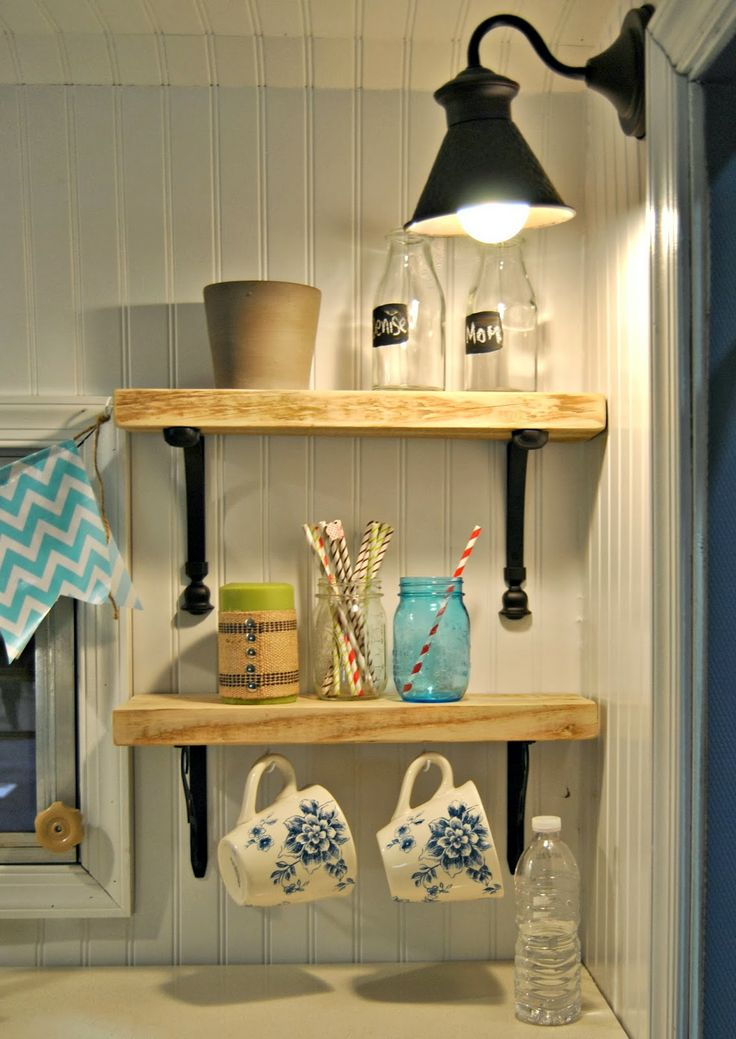 Cute shelves brighten without clutter, like the black sconce, too