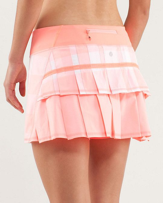 New golf skirt is in order.. love this  peach pink ruffles zip pocket pattern!